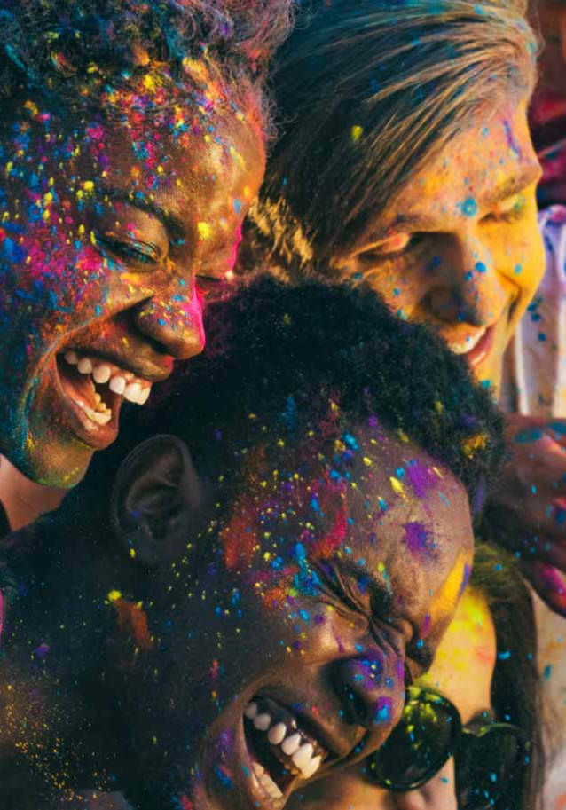 People covered in colors having fun
